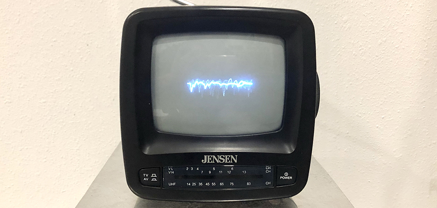 photo of small television with electronic signal line